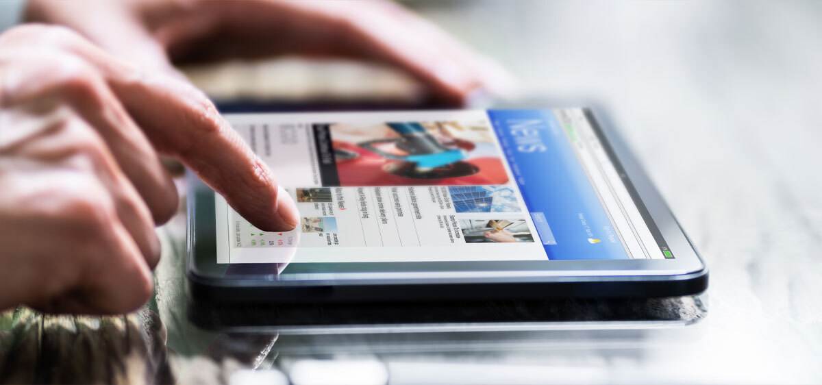 scrolling news on tablet device