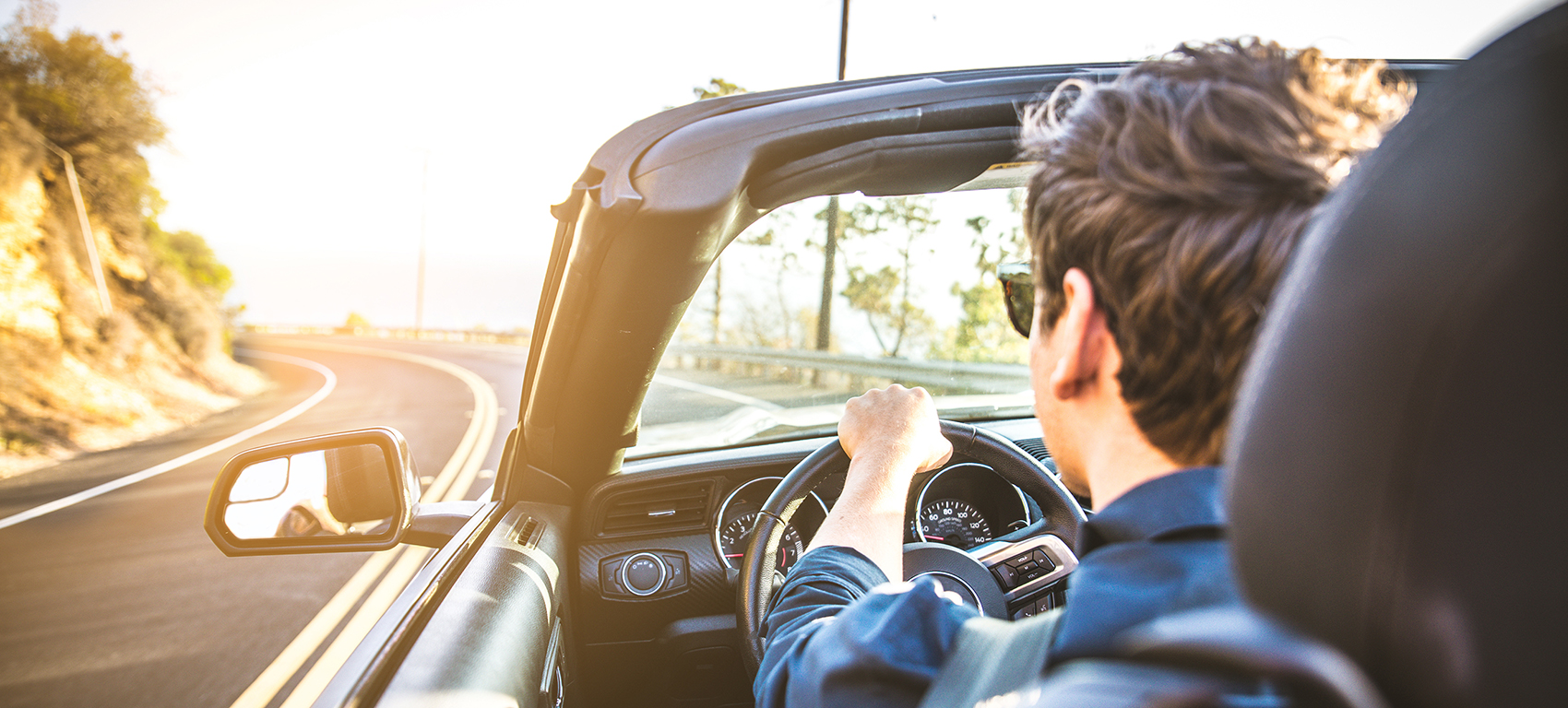 man driving in convertible