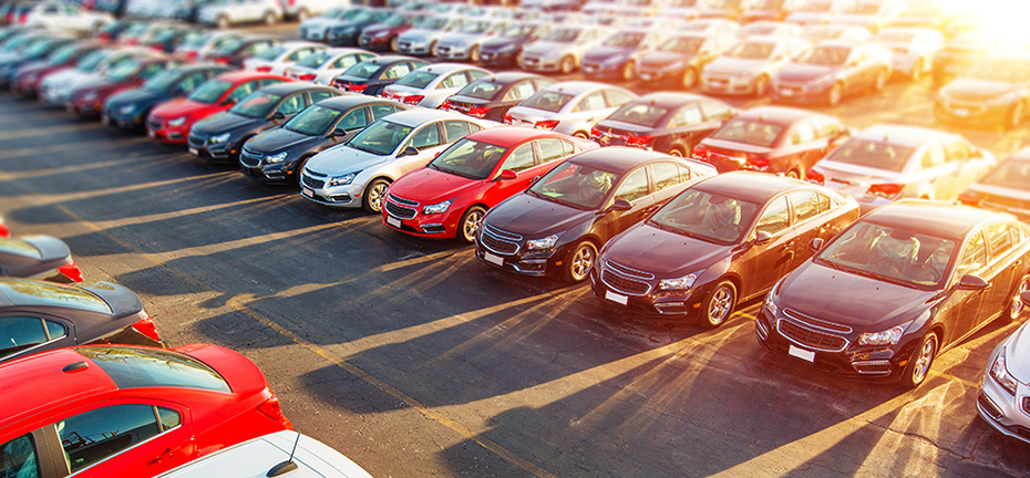 Cars lined up on a car dealership lot