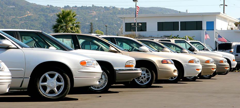 Cars sitting in a car dealership lot