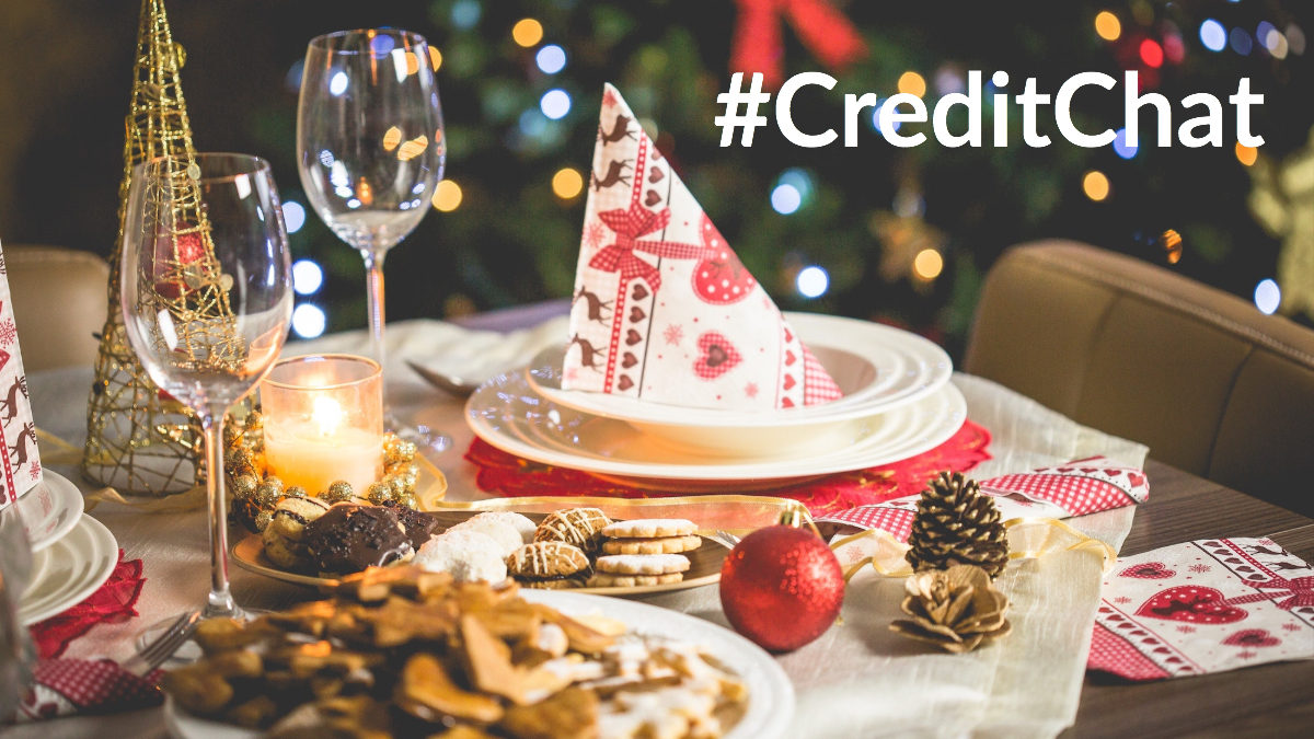Christmas dinner spread with the hashtag #CreditChat in the top corner