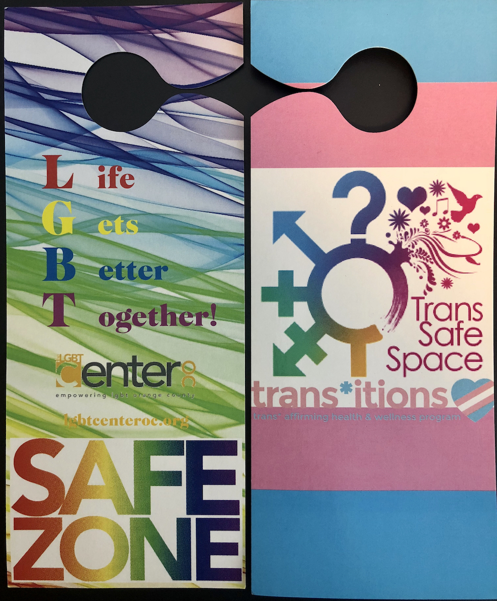 "Two door hangers that say ""LGBT Safe Zone"" and ""Trans Safe Space"""
