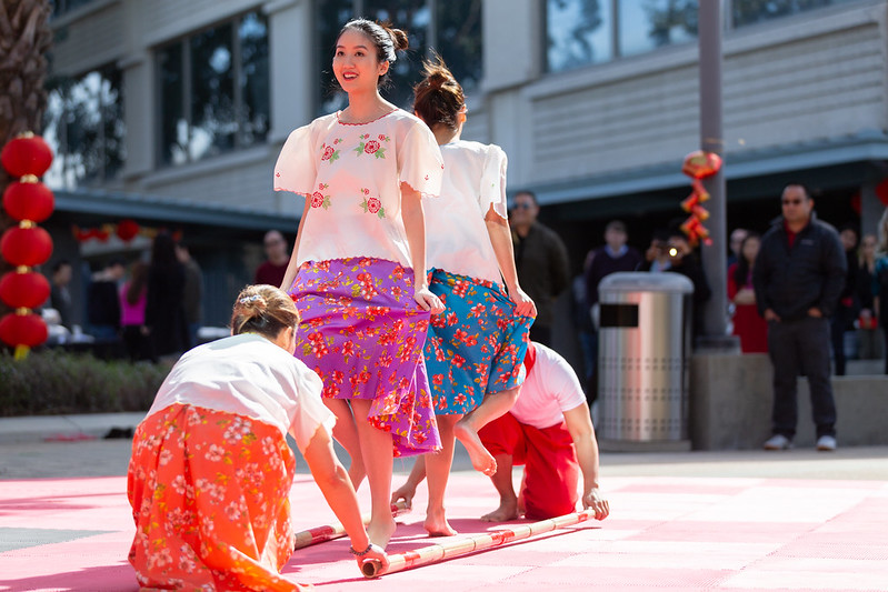 Dancers perform the Filipino folk dance, Tinikling
