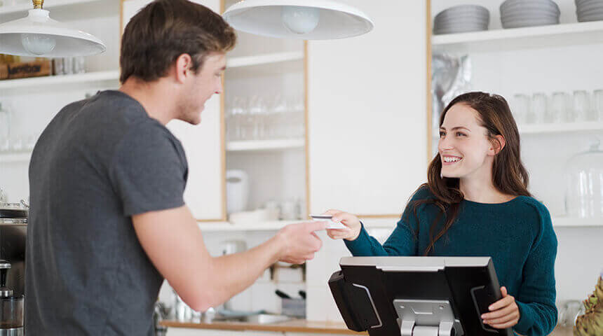 Cashier receiving payment cafe